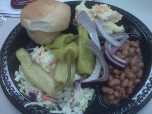 Coleslaw, beans, tater salad, pickles, pepperonici and a roll. YUM!